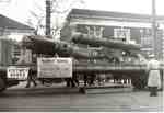 A Victory Bonds parade on Brant Street, displaying an unexploded V1 Robot Bomb, ca 1945