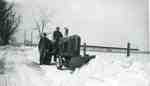 Gordon and Reg Sherwood with a Massey-Harris tractor and snowplow,  plowing out the lane, 1967