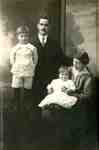 Jim and Ethel (nee Gallagher) Whatmough, with two of their three children, perhaps Maurice and Howard, ca 1918