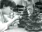 Tammy Dobson, Lord Elgin High School student, decorating chocolate Christmas trees, 1987