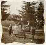 "Children and horse in front of the Devitt Farmhouse, ""Hickory Farm"", ca 1906"