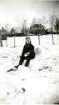 Russ Woodley in the snow chair outside the house on Balmoral Avenue, ca 1939