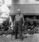 James Garry at Byron Cutter's farmhouse on Gallagher Road,  1955