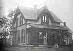 Mrs Joseph J. Burrows (Charlotte, nee Smale) and her son William in front of the Oaklands Gatehouse,  Plains Road, ca 1900