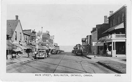 Main Street, Burlington, Ontario, Canada. -- view of street down to lakefront; postmarked July 9, 1952