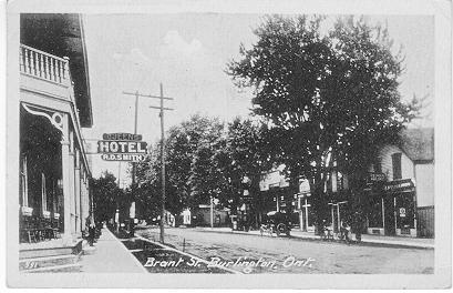 Brant St. Burlington, Ont. -- view of Queen's Hotel sign