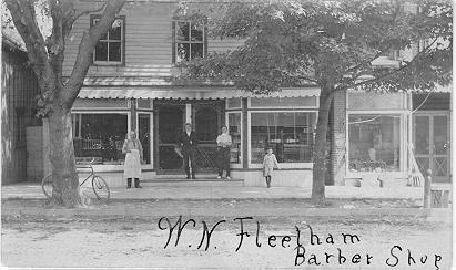 W.N. Fleetham Barber Shop -- Exterior with 4 people in front; dated 1907