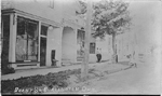 Brant St., Burlington, Ont -- view of H.A. Graham store in foreground, two men standing in middleground