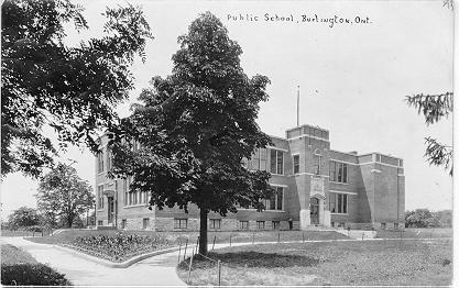 Public School, Burlington, Ont -- Exterior with large tree; psotmarked August 16, 1918