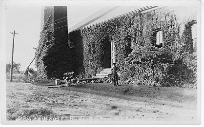 Power House, Burlington Beach, Ont. -- Exterior, with man in front