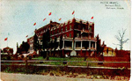 Hotel Brant, Burlington Beach, Burlington, Canada -- Exterior, east end with flags; postmarked May 18, 1910