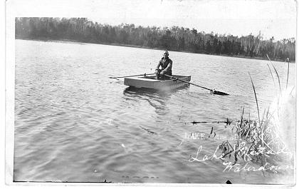 Lake Medad, Waterdown -- Man in rowboat; postmarked May 20, 1940
