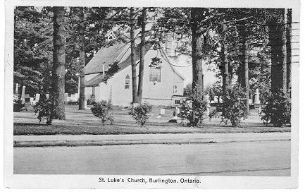 St. Luke's Church, Burlington, Ontario -- Exterior, seen through trees from road; postmarked October 23, 1940