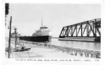 Freighter Entering Canal Swing Bridge, Burlington, Ontario, Canada; postmarked July 9, 1952
