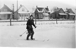 Art Brame Jr. skiing near the railway tracks at Brant Avenue (now Brock Avenue), 1959