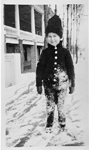 Brant Coleman standing on skates in front of Brant Hotel, winter ca 1915
