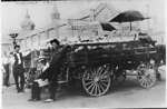 Russell Emery (right) selling melons at the Hamilton Market, 1911