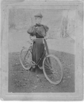 Mrs W. F. W. Fisher with her bicycle, ca 1897
