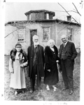William and Barbara Pickett (centre) standing between Keitha (née Pickett) and George S. Henry in front of the Pickett Octagonal House, now 6103 Guelph Line, 1933