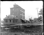 The office  of R. G. Baxter, Banker (left) and the Burlington Roller Mills of the Baxter & Galloway Company, Water Street (now Lakeshore Road) at the foot of Brant Street, near Baxter's Wharf, 1890s