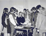 """Students visiting """"Pine Hall"""", the Van Norman - Breckon House, 955 Century Drive, with BHS member Frances Day, ca  1975"""