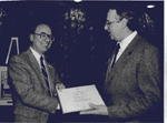 Ken Bolt, right, Chair of the Business Improvement Association (BIA), presenting an award to  the Burlington Spectator, 1987