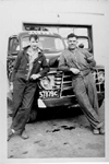 Frank Armstrong and Cam Patterson in front of a J. Cooke Concrete Block Limited truck, ca 1949