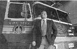 Burlington Deputy Fire Chief James Kay with fire truck, 1997
