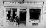 Home Made Candies Store, now 401 Brant Street,  with proprietor Cam Johnston standing by the door, 1922
