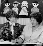 Halton Children's Aid Society Board President Edith Hopkins, with artist Dee White, 1987