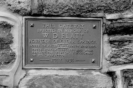 Plaque to W.D. Flatt on the memorial entrance gates to the Cedar Springs community, 1996