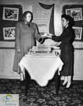 Cutting cake at the Roxy Theatre, Port Stanley, likely during the Grand Opening