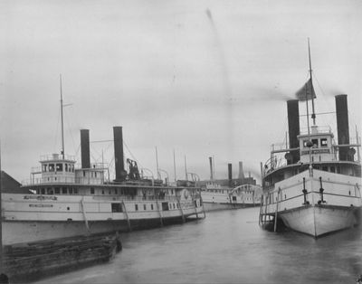 Three vessels moored in Alpena