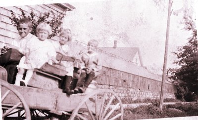 Albert, Margaret, Dorothy, and Leo Linke in Buggy