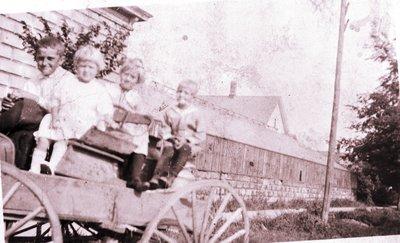 Albert, Margaret, Dorothy, and Leo Linke in Buggy