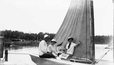 Middle Island:  Family on Sailboat at Dock