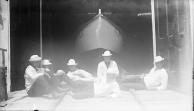 Middle Island:  Crew Outside Surfboat Building