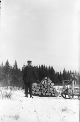 Middle Island:  George and Esther Hartlep with Sleigh of Firewood