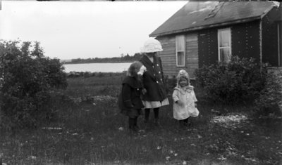 Middle Island:  Esther Hartlep (right) with two unidentified girls.