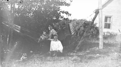 Middle Island:  Esther Hartlep (front) with brother, Don, and mother, Lillian.