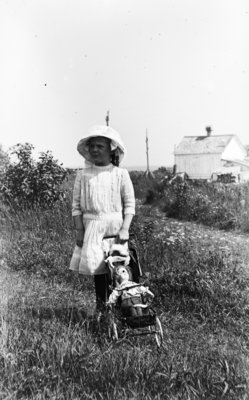 Middle Island:  Esther Hartlep, about age 7 or 8, with doll and stroller.