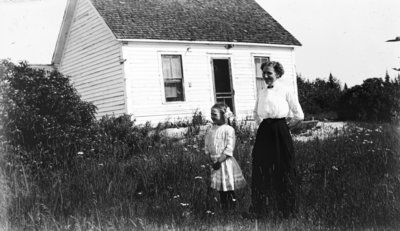 Middle Island:  Esther Hartlep and her mother, Lillian in front of dwelling.