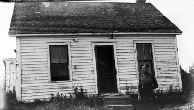 Middle Island:  Lillian Hartlep in front of dwelling.