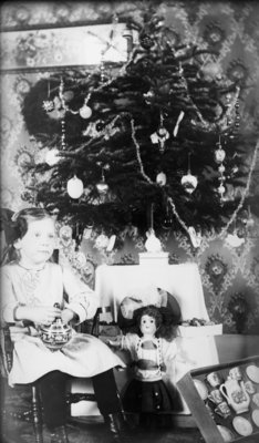 Middle Island:  Esther Hartlep, about age 6, posing next to presents and Christmas Tree in November 1913.