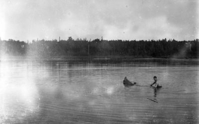 Middle Island:  Unidentified man with sinking canoe