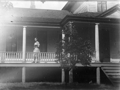 Esther Hartlep on Porch of Family Home at 227 W. Lewis Street in Alpena, Michigan