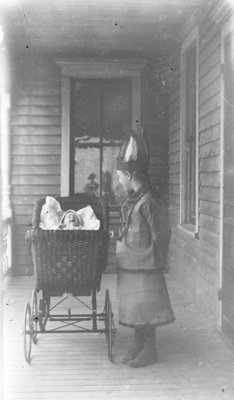 Donald and Esther Hartlep on the Porch of the Family Home at 616 Lockwood Street in Alpena, Michigan.