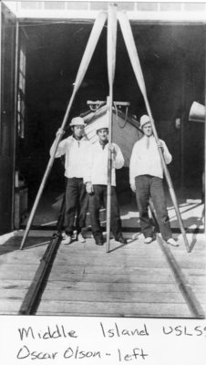 Middle Island:  Crew in front of Surfboat Building