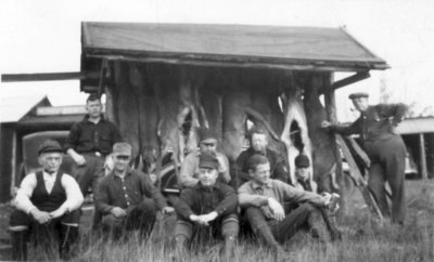 Hunters posing around Deer Pole