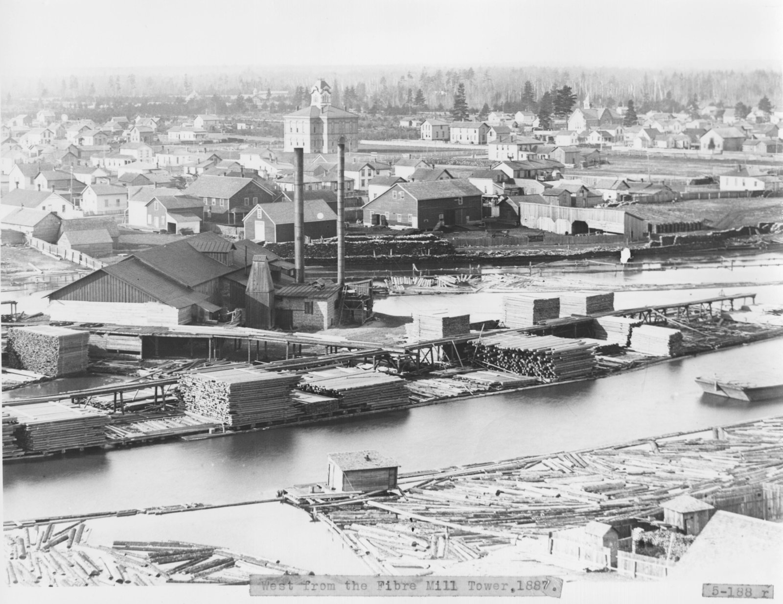 Lumber Mill on Thunder Bay River with Early Alpena County Courthouse in Background